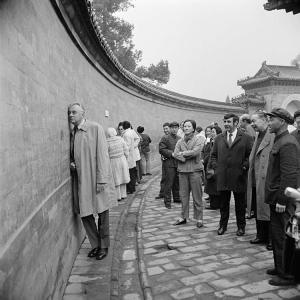 Gough Whitlam listening to Chinese chatter.
